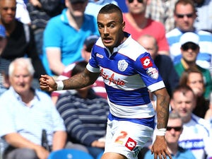 Danny Simpson of Queens Park Rangers controls the ball during the Sky Bet Championship match between Queens Park Rangers and Sheffield Wednesday at Loftus Road on August 3, 2013