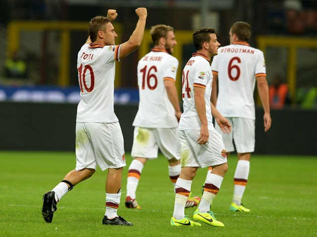 Francesco Totti of AS Roma celebrates scoring the first goal during the Serie A match between FC Internazionale Milano and AS Roma at Stadio Giuseppe Meazza on October 5, 2013