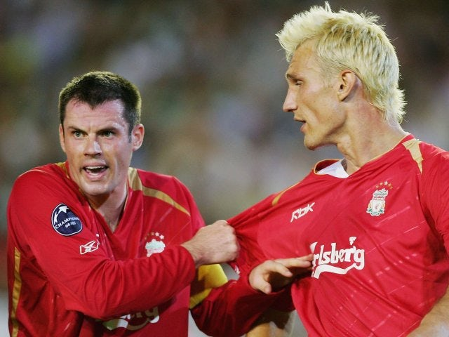 Jamie Carragher and Sami Hyypia discuss tactics during Liverpool's Champions League match with Real Betis in September 2005.