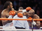 WBA and IBF Heavyweight Champion Evander Holyfield and WBC Heavyweight Champion Lennox Lewis exchange punches in the first round of their Vegas bout on November 14, 1999