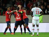 Lille's Senegalese midfielder Idrissa Gueye celebrates with teammates after scoring during a french L1 football match Lille vs Ajaccio on October 05, 2013