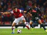 Napoli's Lorenzo Insigne and Arsenal's Aaron Ramsey battle for the ball during their Champions League match on October 1, 2013