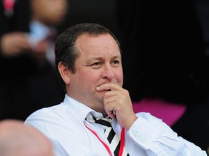 Newcastle owner Mike Ashley looks on before the Barclays Premier League match between Cardiff City and Newcastle United at Cardiff City Stadium on October 5, 2013