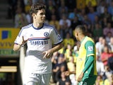 Chelsea's Brazilian midfielder Oscar celebrates scoring his goal during the English Premier League football match between Norwch City and Chelsea at Carrow Road in Norwich on October 6, 2013