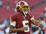 Quarterback Pat White #5 of the Washington Redskins warms up for play against the Tampa Bay Buccaneers August 29, 2013