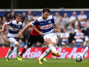 Charlie Austin of QPR scores the tea'ms second goal of the game from the penalty spot during the Sky Bet Championship match between Queens Park Rangers and Barnsley at Loftus Road on October 05, 2013