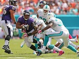 Ray Rice of the Baltimore Ravens rushes during a game against the Miami Dolphins at Sun Life Stadium on October 6, 2013