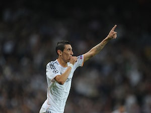 Angel Di Maria of Real Madrid CF celebrates after scoring Real's 3rd goal during the UEFA Champions League match between Real Madrid CF and FC Copenhagen at Estadio Santiago Bernabeu on October 2, 2013