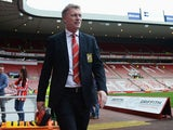 David Moyes, manager of Manchester United walks pitchside prior to the Barclays Premier League match between Sunderland and Manchester United at the Stadium of Light on October 5, 2013