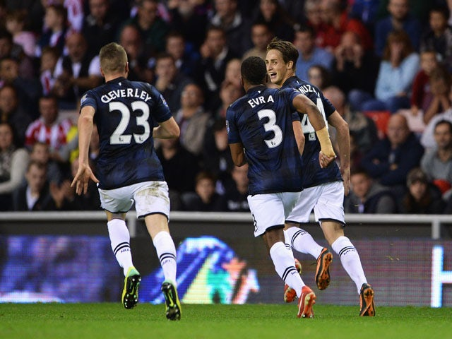 Adnan Januzaj of Manchester United celebrates scoring his team's second goal with Patrice Evra and Tom Cleverley during the Barclays Premier League match between Sunderland and Manchester United at the Stadium of Light on October 5, 2013