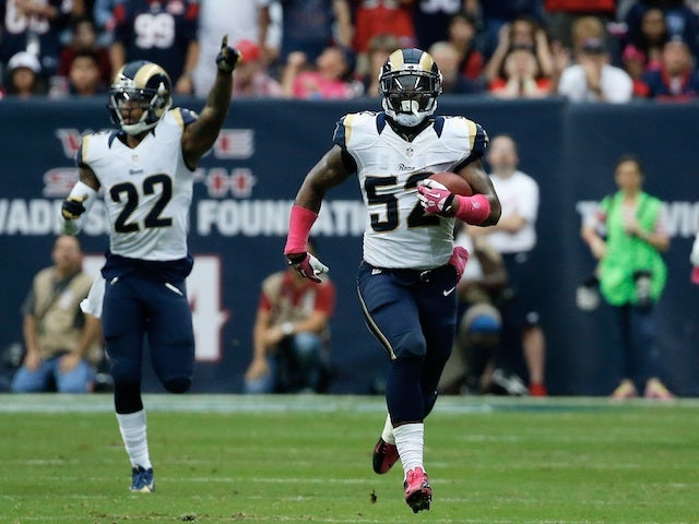 Alec Ogletree of the St. Louis Rams returns an interception 98 yards for a touchdown in the third quarter against the Houston Texans at Reliant Stadium on October 13, 2013