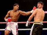 Anthony Joshua catches Emanuele Leo during their Heavyweight bout at O2 Arena on October 5, 2013