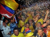 Colombian fans celebrate in Bogota after their team qualified for the Brazil 2014 FIFA World Cup on October 11, 2013