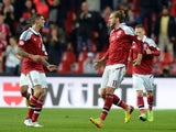 Nicklas Bendtner #11 of Denmark celebrates after scoring his team's first goal to equalise during the FIFA 2014 world cup qualifier between Denmark and Italy on October 11, 2013