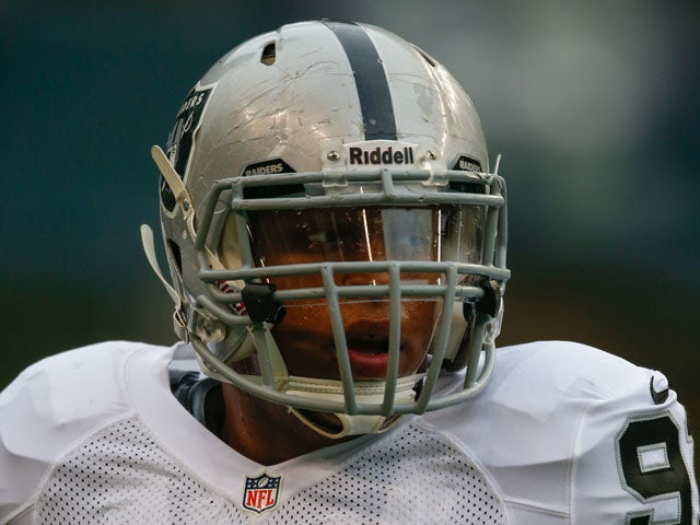 Defensive end Jack Crawford #91 of the Oakland Raiders looks on prior to the game against the Seattle Seahawks at CenturyLink Field on August 29, 2013