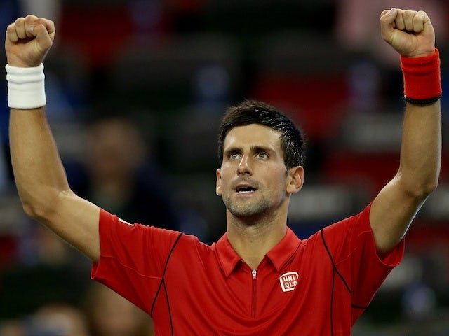 Novak Djokovic of Serbia celebrates his win over Fabio Fognini of Italy during the Shanghai Rolex Masters at the Qi Zhong Tennis Center on October 10, 2013