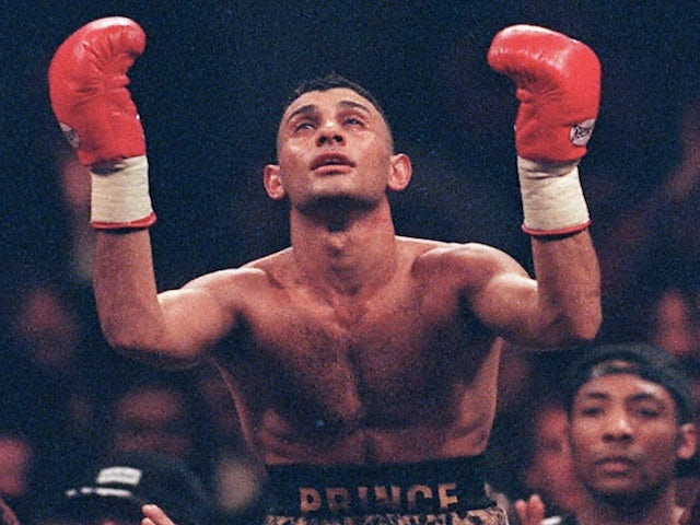 Prince Naseem Hamed, WBO world champion, is lifted high above the crowd after beating Tom Johnson on February 3, 1997