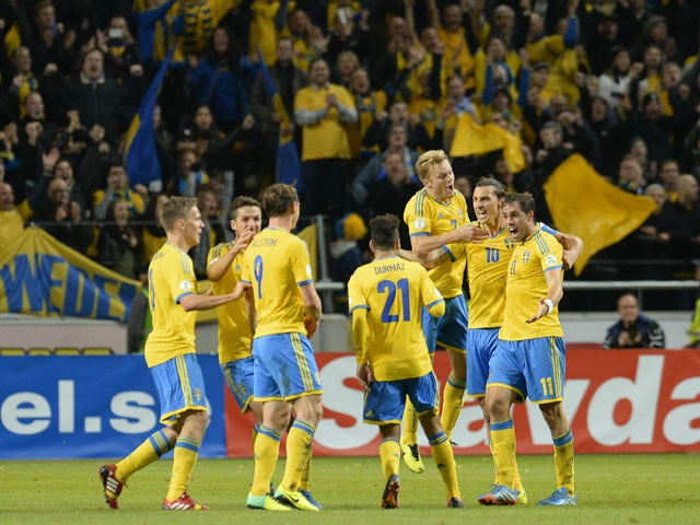 Sweden's players celebrate after the FIFA 2014 World Cup group C qualifying football match Sweden vs Austria on October 11, 2013