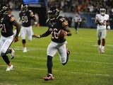 Tim Jennings #26 of the Chicago Bears runs back an interception for a touchdown against the New York Giants during the first quarter on October 10, 2013