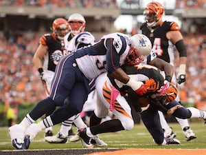 Tommy Kelly #93 of the New England Patriots sacks quarterback Andy Dalton #14 of the Cincinnati Bengals on the two-yard line in the third quarter at Paul Brown Stadium on October 6, 2013