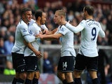 Spurs player Andros Townsend (2nd left) sheepishly celebrates his goal with team mates after opening the scoring during the Barclays Premier League match between Aston Villa and Tottenham Hotspur at Villa Park on October 20, 2013