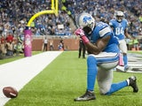 Tight end Brandon Pettigrew #87 of the Detroit Lions celebrates after he ran in a touchdown during the first half against the Cincinnati Bengals at Ford Field on October 20, 2013