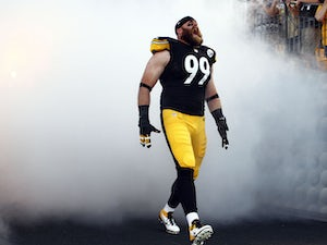 Brett Keisel #99 of the Pittsburgh Steelers screams while being introduced before the game against the Kansas City Chiefs on August 24, 2013