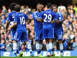 Chelsea's Belgian midfielder Eden Hazard celebrates with teammates after scoring his team's first goal during the English Premier League football match between Chelsea and Cardiff City at Stamford Bridge in west London on October 19, 2013