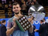 Bulgaria's Grigor Dimitrov celebrates with the trophy after winning against Spain's David Ferrer in the ATP Stockholm Open tennis tournament final match on October 20, 2013