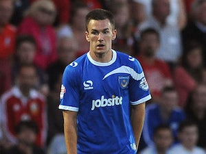 Jed Wallace of Portsmouth attacks during the Capital One Cup First Round match between AFC Bournemouth and Portsmouth at The Goldsands Stadium on August 06, 2013