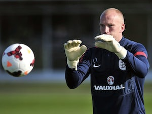 England goalkeeper John Ruddy catches the ball during a training session at London Colney on October 10, 2013