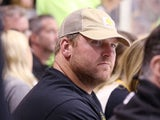 Logan Mankins watchs the game between the Chicago Blackhawks and the Boston Bruins in Game Six of the Stanley Cup Final at the TD Garden on June 24, 2013