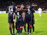 Bordeaux' Polish midfielder Ludovic Obraniak is congratulated by teammates after scoring a goal against Lyon on October 20, 2013
