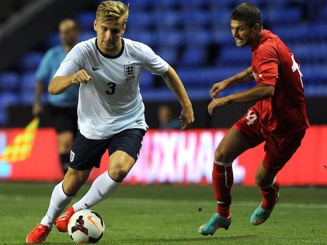 Luke Shaw of England (L) attacks during the 2015 UEFA European U21 Championships Qualifier between England U21 and Moldova U21 at The Madejski Stadium on September 5, 2013