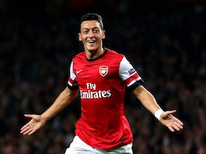 Arsenal midfielder Mesut Ozil celebrates scoring the opening goal against Napoli in the Champions League at the Emirates on October 1, 2013