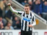 Paul Dummett of Newcastle United celebrates scoring their second goal during the Barclays Premier League match between Newcastle United and Liverpool at St James' Park on October 19, 2013