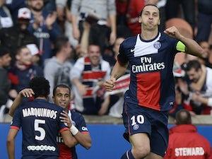 Paris Saint-Germain's Swedish forward Zlatan Ibrahimovic celebrates after scoring a goal during the French L1 football match Paris Saint Germain (PSG) against Bastia (SCB) on October 19, 2013