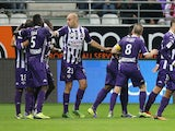Toulouse's teammates celebrate after Oscar Trejo scored a goal during the French L1 football match Reims vs Toulouse on October 18, 2013