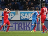 Leverkusen's Stefan Kiessling reacts after he thinks he missed a chance but the referee awarded the goal, 2-0, despite angry protests during the German first division Bundesliga football match TSG 1899 Hoffenheim vs Bayer 04 Leverkusen in Sinsheim, German