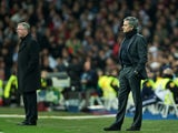 Alex Ferguson and Jose Mourinho stand on the Bernabeu touchline in February 2013.