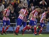 Atletico Madrid's Forward Oliver celebrates with teammates after scoring during the Spanish league football match Club Atletico de Madrid vs Betis at the Vicente Calderon stadium in Madrid on October 27, 2013