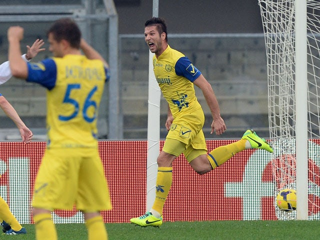 Bostjan Cesar of AC Chievo Verona celebrates scoring the first goal during the Serie A match between AC Chievo Verona and ACF Fiorentina at Stadio Marc'Antonio Bentegodi on October 27, 2013
