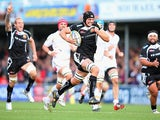 Exeter Chiefs' Dean Mumm run clear to score a try against Worcester Warriors on October 26, 2013