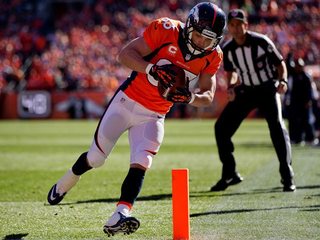 Wide receiver Wes Welker #83 of the Denver Broncos tip-toes into the end zone for a touchdown after making a reception during the first quarter against the Washington Redskins at Sports Authority Field Field at Mile High on October 27, 2013