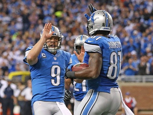 Matthew Stafford #9 of the Detroit Lions celebrates with teammate Calvin Johnson #81 after a first quarter touchdown the game against the Dallas Cowboys at Ford Field on October 27, 2013