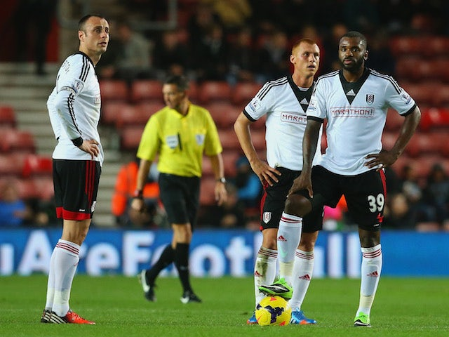 Dimitar Berbatov and Darren Bent of Fulham look on during the Barclays Premier League match between Southampton and Fulham at St Mary's Stadium on October 26, 2013