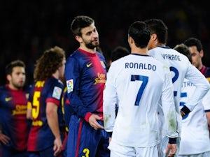 Pique, Adriano to miss Milan clash?
