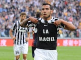 Carlos Tevez of Juventus celebrates a goal during the Serie A match between Juventus and Genoa CFC at Juventus Arena on October 27, 2013