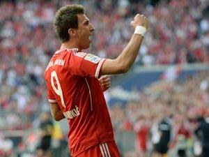 Bayern's Mario Mandzukic celebrates after scoring his team's opening goal against Hertha Berlin on October 26, 2013