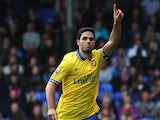Arsenal's Mikel Arteta celebrates after scoring the opening goal via the penalty spot against Crystal Palace on October 26, 2013